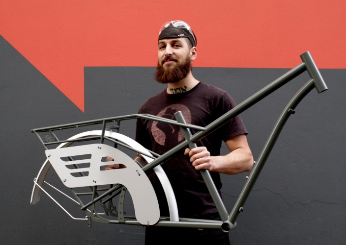 Kinn's Max Miller modeling the Cascade Flyer's spokeguards made in our Portland workshop at ADX